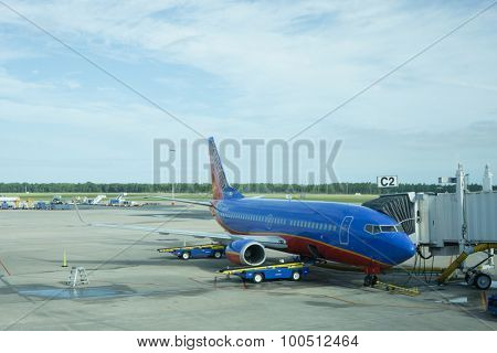 JACKSONVILLE, FLORIDA - AUGUST 30, 2015: A Southwest airplane parked at the Jacksonville Airport terminal. Southwest Airlines has nearly 46,000 employees and operates more than 3,400 flights per day.