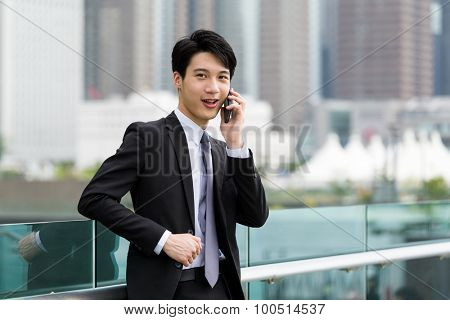 Businessman discuss about something though cellphone
