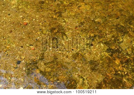 Abstract texture river creek  stream, water on yellow ravel