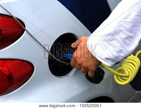 A Man Recharge His Car