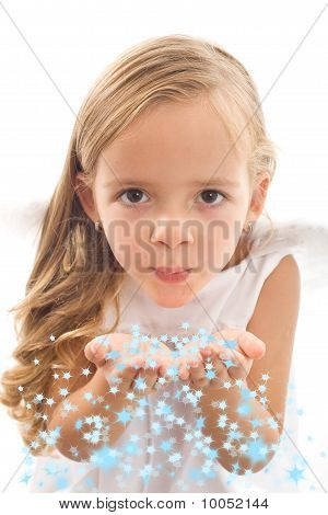 Little Girl Blowing Stars From Her Palms