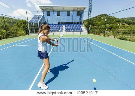 Female Tennis Player Performing A Drop Shot