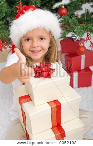 Happy Little Girl With Lots Of Christmas Presents