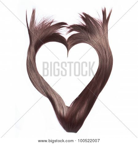 Heart shape from beautiful brown hair, isolated on white background