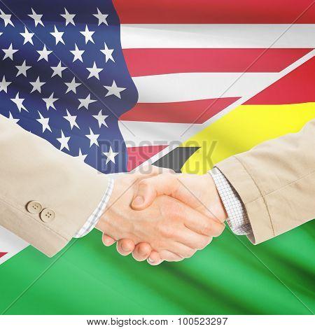 Businessmen Handshake - United States And Ghana