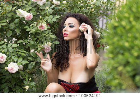 Splendid Young Woman Posing Near Bush
