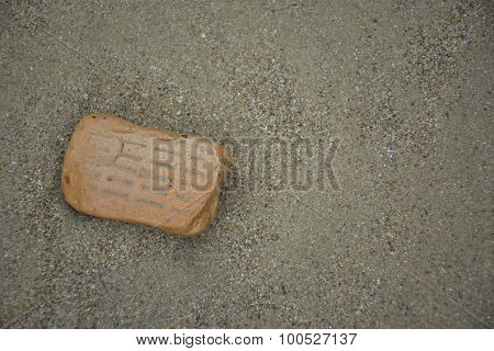 A Broken Brick On The Beach