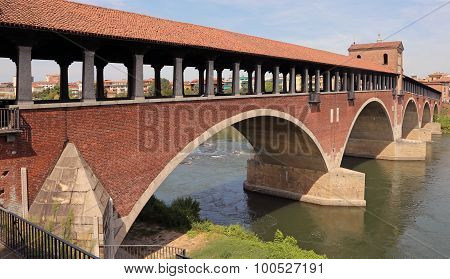 Covered Bridge Over The Ticino River In Pavia City In Italy