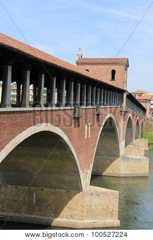 Covered Bridge Over The Ticino River In Pavia City
