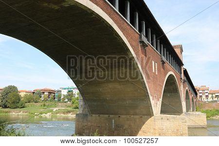 Historical Covered Bridge Over The Ticino River In Pavia City
