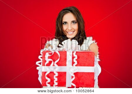 Woman Holding Big Christmas Present