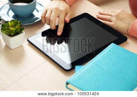 Woman using PC tablet at home
