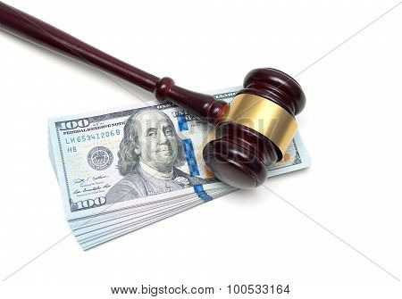 Gavel And Stack Of Us Dollars On A White Background
