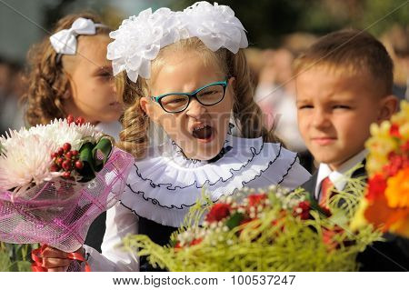 Orel, Russia - September 1, 2015: Girl In School Uniform With Bouquet Yawning
