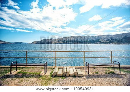 Beautiful Coastline With Dramatic Sky And Sunlight. Rocky Coastline With Ocean Waves And Viewpoint.