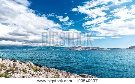 Panoramic View Of Island Coastline Landscape, Calm Water, Clear Sky On A Sunny Vacation Day. Seaside