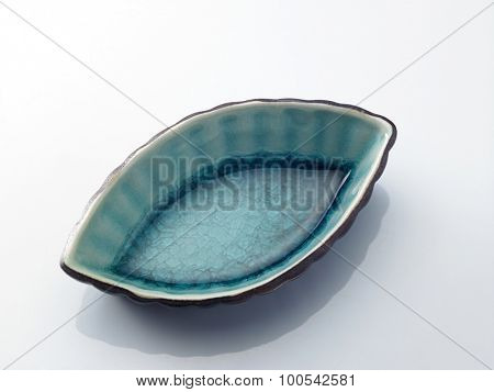 saucer made of clay on white background