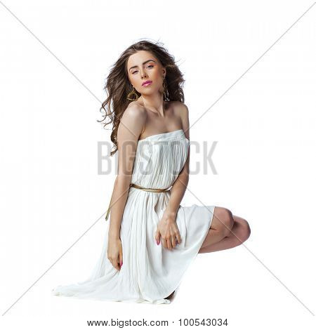 Portrait of young woman in sexy white dress