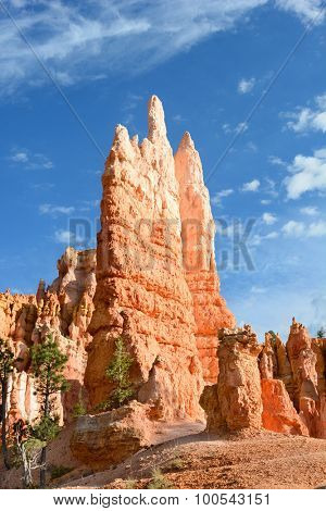 Hoodoos in Bryce Canyon, Utah. A hoodoo, also called a tent rock, fairy chimney, and earth pyramid, is a tall, thin spire of rock that protrudes from the bottom of an arid drainage basin or badland.