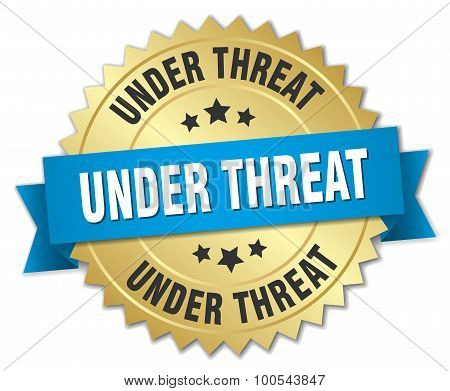 Under Threat 3D Gold Badge With Blue Ribbon