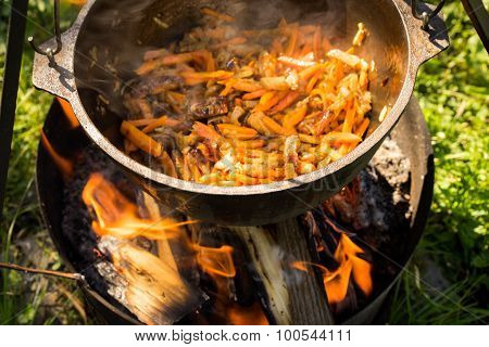 Cooking Meat With Vegetables, Carrots, Onions. National Caucasian Cuisine