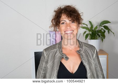 Portrait Of A Smiling Businesswoman At Office