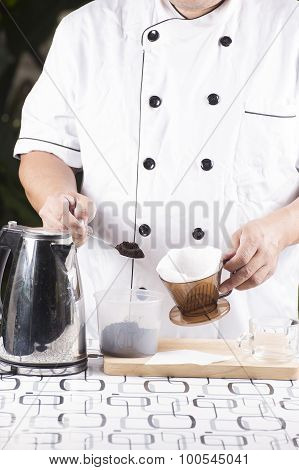 Putting Grind Cofffe Into Filter Cup