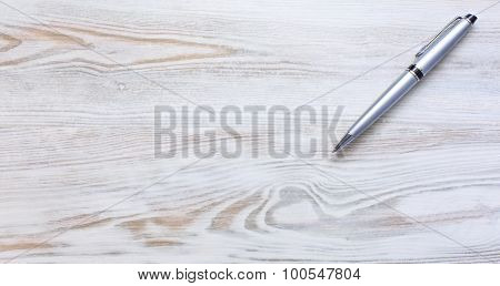 Wooded desk with executive style pen