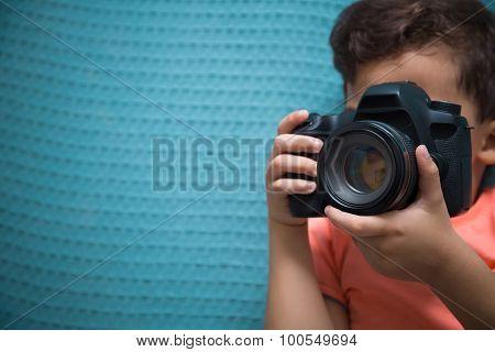 Little Boy Using Camera