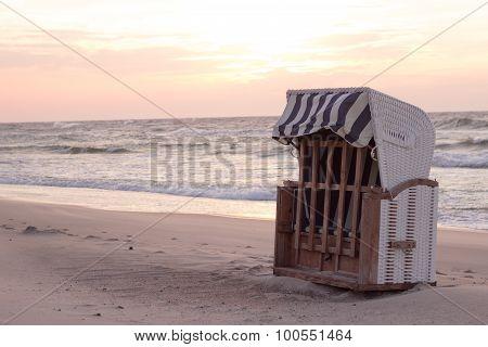 basket beach chair on the sand coast