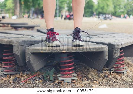 Woman Standing On Springs In Playground