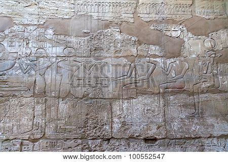 Mortuary Temple Of Hatshepsut In Deir El-bahari. Ancient Wall With The Engraved Egyptian Hieroglyphs