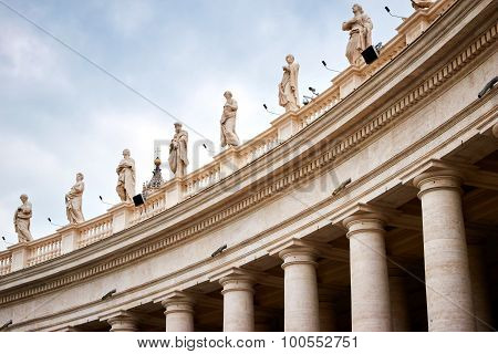 Colonnades That Surround St. Peter's Square In Rome, Vatican City, With Many Statues On Top
