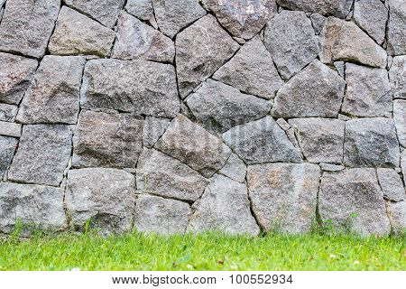Background Of A Stone Wall  In A Lawn