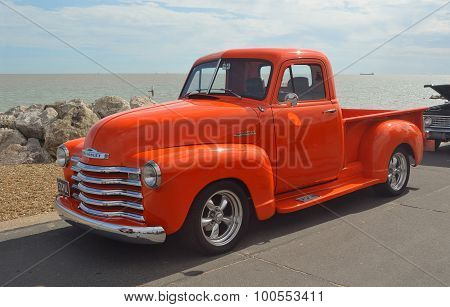 Classic Bright Orange Chevrolet pickup truck