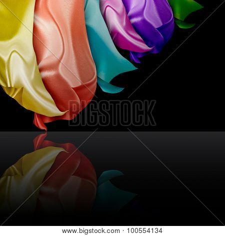 colorful silk curtains on black background