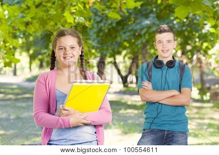 Portrait of happy school kids outdoors