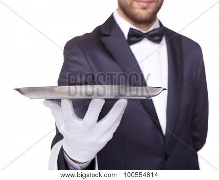 Cropped image of a waiter holding an empty silver tray, isolated on white background