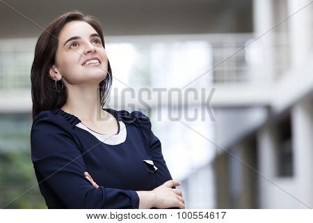 Portrait of a thoughtful business woman at modern office building