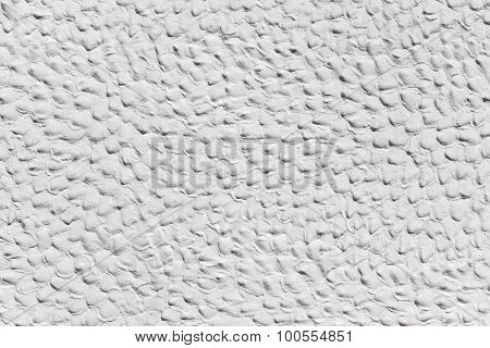 White plasterwork with humpy surface