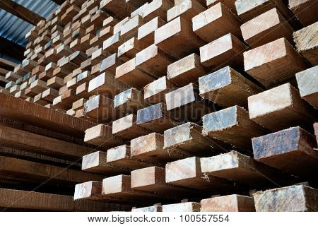 Stock Of Timber Wood Construction In Warehouse.