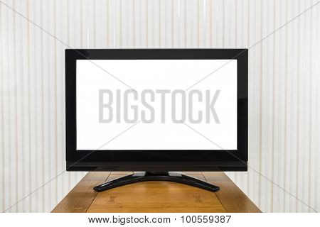 Modern television on wood table with cut out screen.