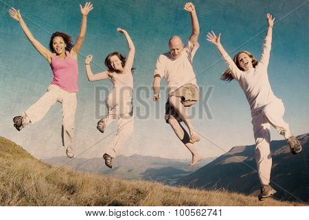 Group of young people jumping in the field Concept