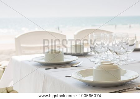 Table setting near beach restaurant