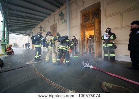 MOSCOW - December 8, 2014: Firemen with equipment prepare to extinguish a fire in  State Academic Bolshoi Theatre of Russia Historical scene