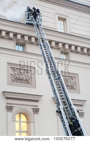 MOSCOW - December 8, 2014: Firefighters at the fire stairs rise to the burning window of State Academic Bolshoi Theatre of Russia Historical scene