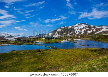 VALDRES, NORWAY - 6 JULY, 2015: Stunning nature on Valdresflya, green covered landscape stretches fa