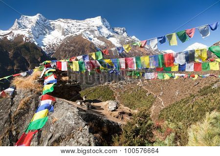 Prayer Flags And Mount Kongde Near Namche Bazar Village