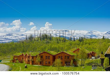 VALDRES, NORWAY - 6 JULY, 2015: Traditional Norwegian mountain cabins of wood with grassy rooftops s