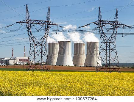 Power Plant Dukovany With Golden Rapeseed Field